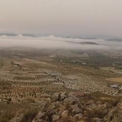 View from Cerro de la Cruz overlooking the land, up above the clouds